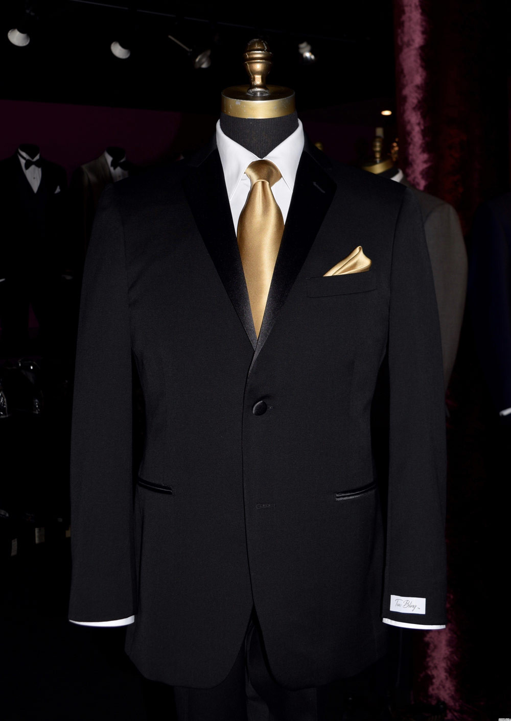 black tuxedo with gold silk long tie and pocket hanky